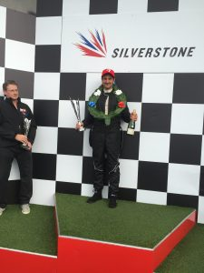 Gareth Montgomery, owner of Autologik Motorsport on the podium at Silverstone