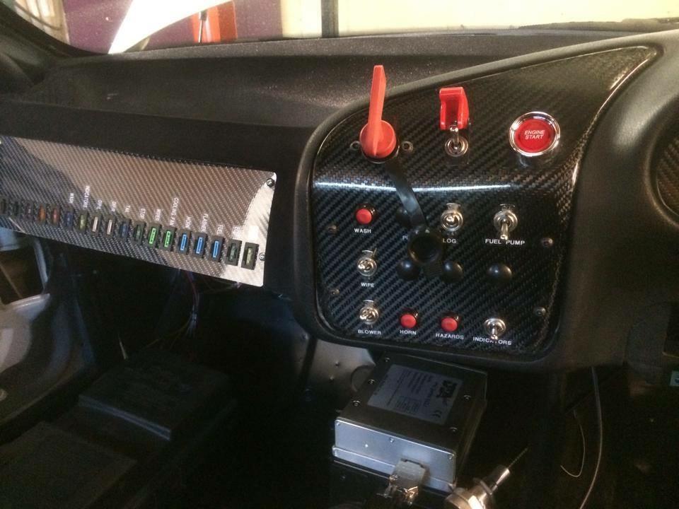Carbon fibre custom made switch panel, set into custom flocked dash.